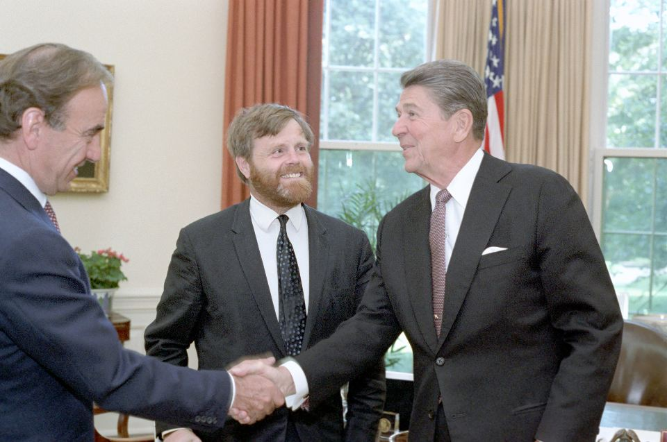 President Ronald Reagan meets with Charles Douglas-Home, editor of London Times, and its publisher Rupert Murdoch in the Oval Office on July 7, 1983. (Photo credit: Reagan presidential library)