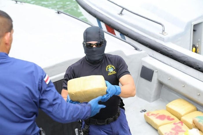 Drug seizure: Agents from the National Coast Guard and Drug Control Agency unload 810 kilos of cocaine seized on January 14 off the Pacific coast of Costa Rica. U.S. and Colombian P-3 Orion aircraft provided Coast Guard officials with intelligence to make the bust. (Courtesy of the Ministry of Public Security)