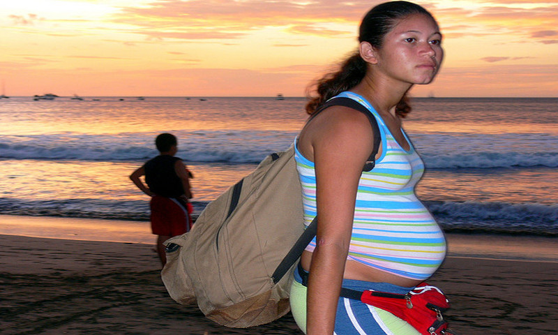 Pregnant Girl Selling Pottery on Beach - Costa Rica.  From Flickr.com