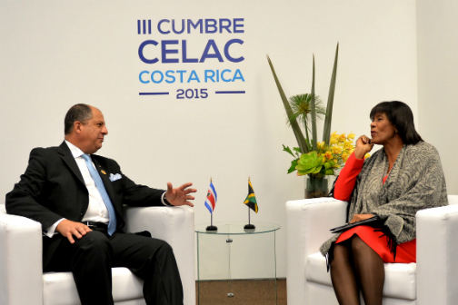 Jamaica's Prime Minister Portia Simpson Miller with the Costa Rica's President Luis Guillermo Solis Rivera CELAC summit in San José, January 28-29).