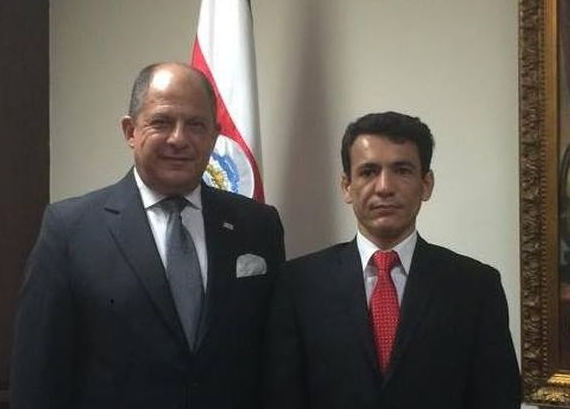 Roberto Zamora (right) with President Luis Guillermo Solis (left) from Facebook photo.