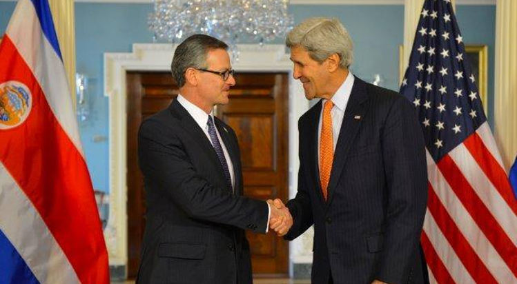 Costa Rica's Foreign Minister, Mauricio Gonzales (left) shakes hand with U.S. Secretary of State, John Kerry, in Washington on Friday.