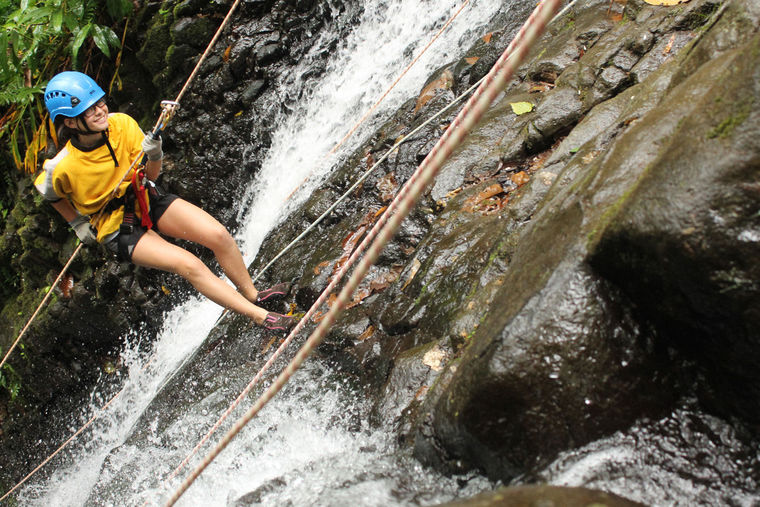 Rose Wine rappels down one of four waterfalls just minutes away from the town.