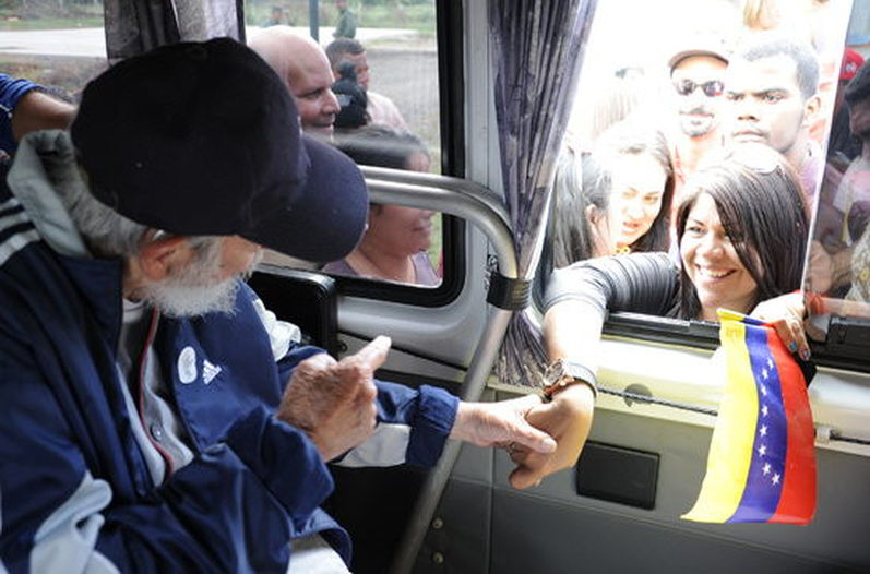 ormer Cuban president Fidel Castro greets a delegation of Venezuelan who are in Cuba to take part in social and political activities, in La Habaa (Havana) on March 30, 2015.