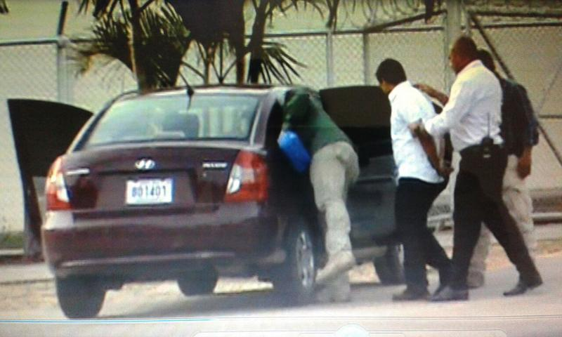 Bank teller of the Limonal branch of the Banco Nacional being detained by OIJ agents.
