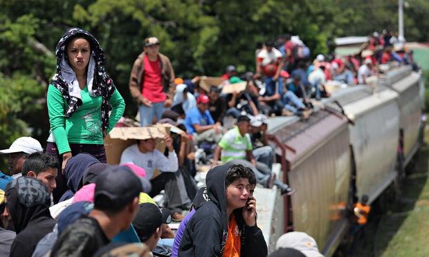 Migrants ride north on top of 'la bestia', heading for the US border
