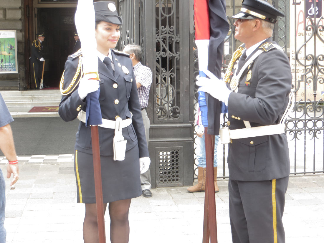 Attired in their finest dress-blues, these fire fighters prepare to carry the colors to the dignitary's stage
