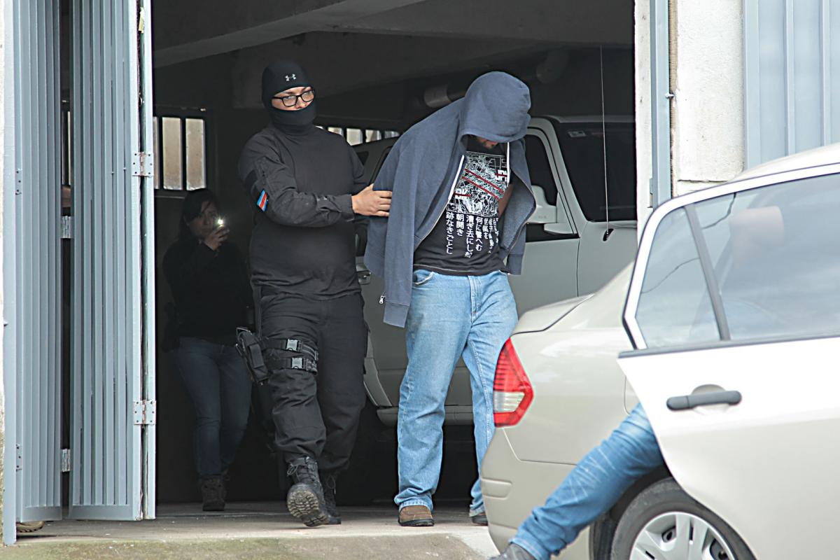 Rivera Sanchez in police custody after a raid on his home in Heredia Tuesday, The man was released without precautionary measures on Wednesday