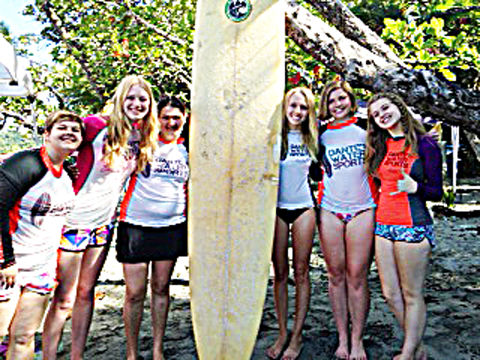 Wyndmere High School students who went on an educational experience to Costa Rica are shown here by a surfboard. They are Sasia Heitkamp, Ana Braaten, Abbi Metzger, Macy Wright, Carlie Brown and Catherine Manstrom.