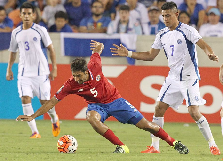 Costa Rica Celso Borges (5) is tripped by Salvador Darwin Ceren (7) in the second half in the Gold Cup action on Saturday, July 11, 2015 at BBVA Stadium in Houston, TX. The game ended 1 to 1.