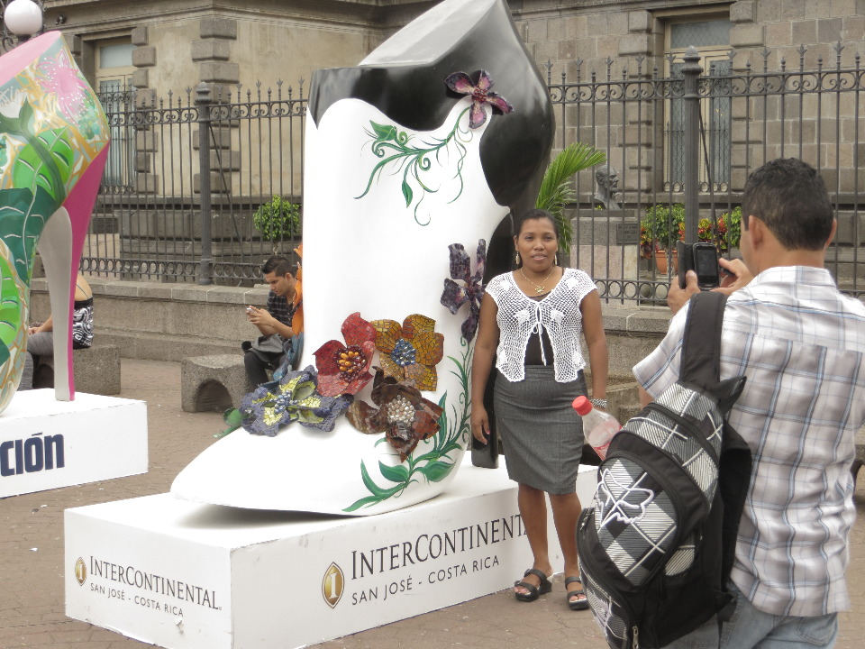 Visitors to the Plaza pose next to the shoes they like.