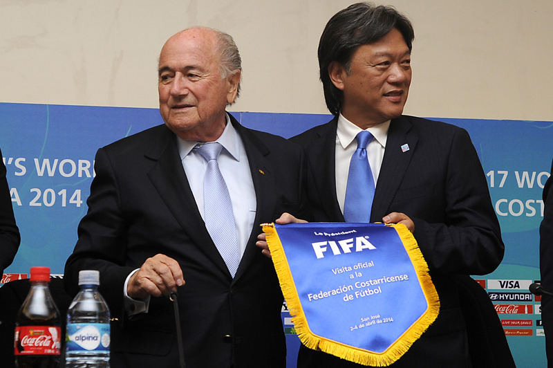 Eduardo Li (right) with Joseph Blatter, who has served as the eighth president of FIFA since June 1998.