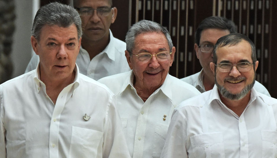 "Colombian President Juan Manuel Santos (left), Cuban Presisdent Rual Castro (centre) and FARC leader Timoleom Jimenez, alias ""Timochenko,"" (right)"