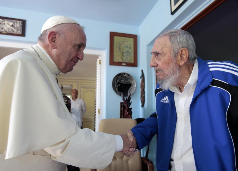 Pope Francis and Fidel Castro shake hand at Castro's residence. Photo Alex Castro/AP
