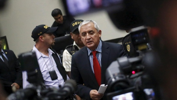 """Guatemala's former President Otto Perez Molina (C) speaks with the media after a hearing at the Supreme Court of Justice in Guatemala City. 