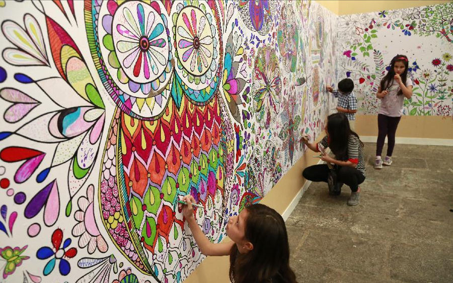 Children paint a mural during the 16th International Book Fair in San Jose, capital of Costa Rica, on Sept. 19, 2015. According to the organizers, during the event expositors, lecturers, authors, scientists and artists will give talks on literary creation, and it will take place until Sept. 27