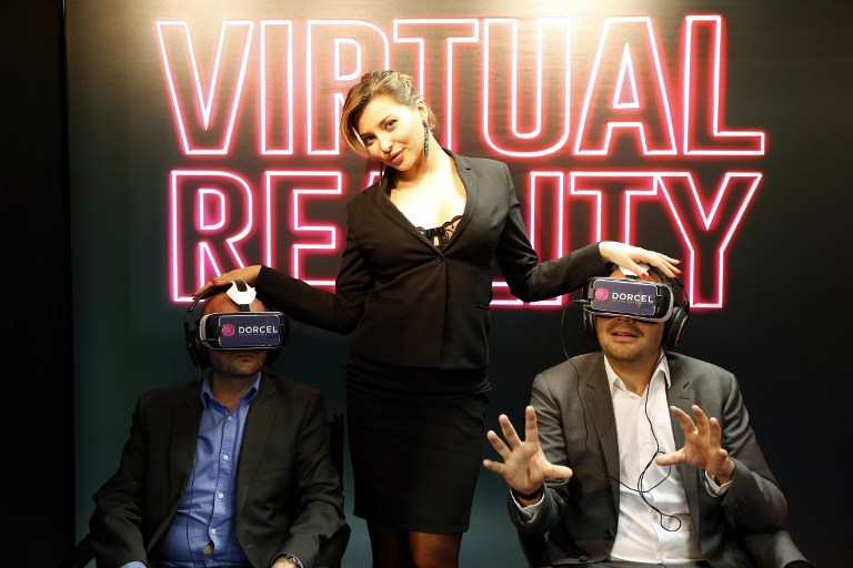 French porn actress Anna Polina poses during a presentation of a short erotic film in virtual reality during the MIPCOM audiovisual trade fair in Cannes, southeastern France, on October 5, 2015. The film, by Marc Dorcel, French producer and distributor of porn films, was presented to demonstrate the technological lead of the group, as the porn industry is looking toward virtual reality technology, hoping to retain viewers who prefer free online content. AFP PHOTO / VALERY HACHE