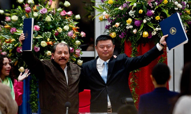 Wang Jing (right) of HKND pictured with Nicaraguan president Daniel Ortega and the agreements for the construction of the interoceanic canal in 2013. Photograph: Esteban Felix/AP