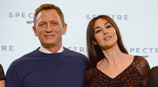 IVER HEATH, ENGLAND - DECEMBER 04:  (EMBARGOED FOR PUBLICATION IN UK TABLOID NEWSPAPERS UNTIL 48 HOURS AFTER CREATE DATE AND TIME. MANDATORY CREDIT PHOTO BY DAVE M. BENETT/WIREIMAGE REQUIRED)  Daniel Craig (L) and Monica Bellucci attend a photocall with cast and filmmakers to mark the start of production which is due to commence on the 24th Bond Film and announce the title of the film as 'Spectre' at Pinewood Studios on December 4, 2014 in Iver Heath, England. (Photo by Dave M. Benett/WireImage)