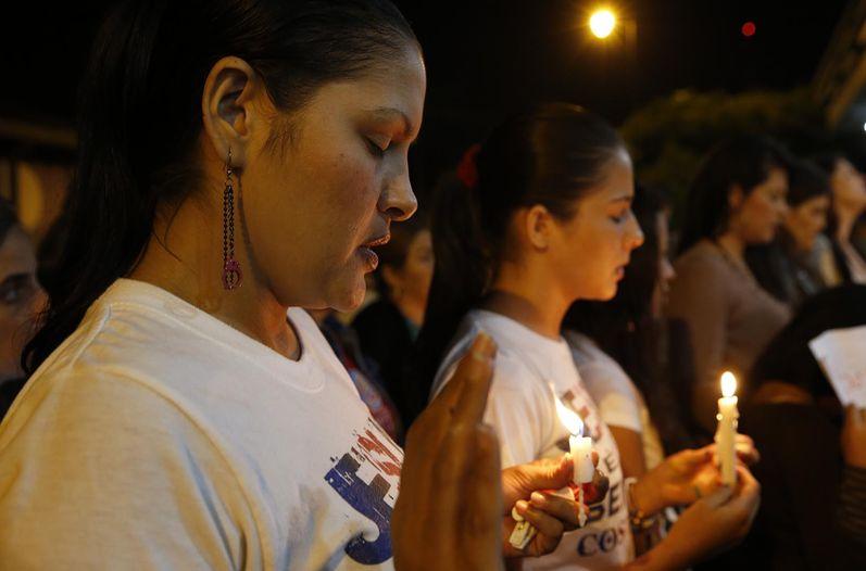 Dozens are keeping vigil for Gerardo Cruz outside the Hospital Calderon Guardia. Photo Mayela Lopez / La Nacion