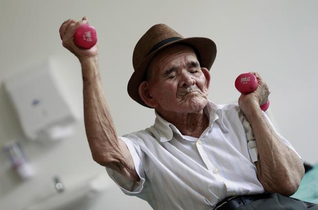 "Costa Rica's Jose Uriel Delgado Corrales, 115, better known locally as ""Chepito"" exercises during an individualized therapy at nursing home Ancianos de Piedades de Santa Ana (San Jose), August 11, 2015."