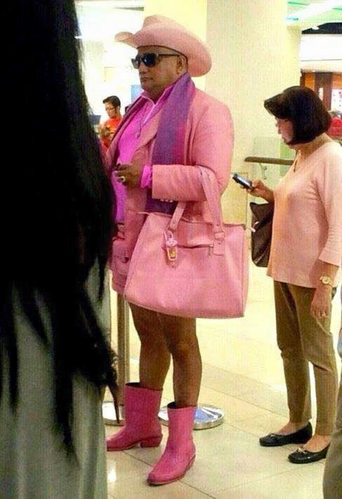 Found on Facebook. Will anyone notice the man dressed in drag to bank at the new bank?