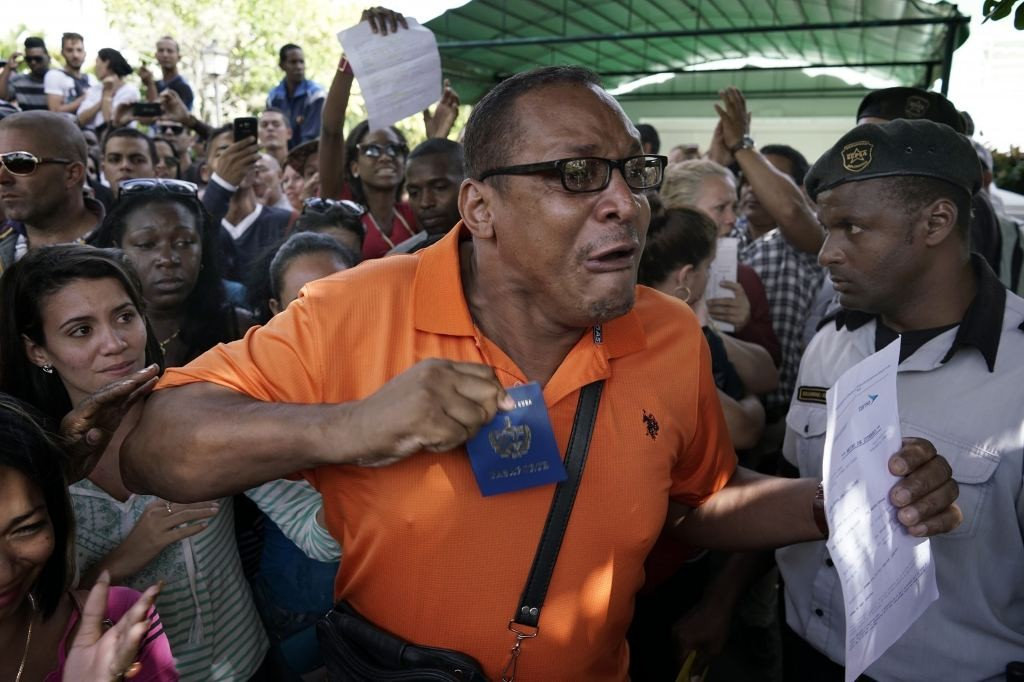 Cubans gather outside Ecuador's embassy, expressing frustration at a new visa rule that now requires they have a visa to visit the South American country, in Havana, Cuba, Friday, Nov. 27, 2015. The lack of a visa requirement for Cubans made Ecuador a favored destination for those seeking to leave the island and make the overland route to the United States, where they can receive automatic legal residency. Some came with plane tickets, and flight itineraries, demanding reimbursement of the cost of their airline tickets with destination to Ecuador. (Ramon Espinosa/Associated Press)