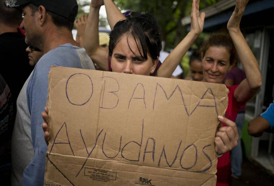 """""""Obama Help Us"""" reads the makeshift sign by Cuban migrants not able to north, after Nicaragua shuts its borders to them"""