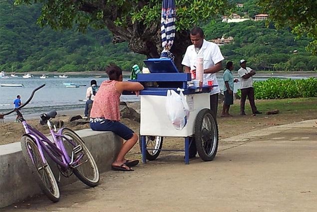 A vendor at Coco beach selling copos. Photo Mytanfeet.com
