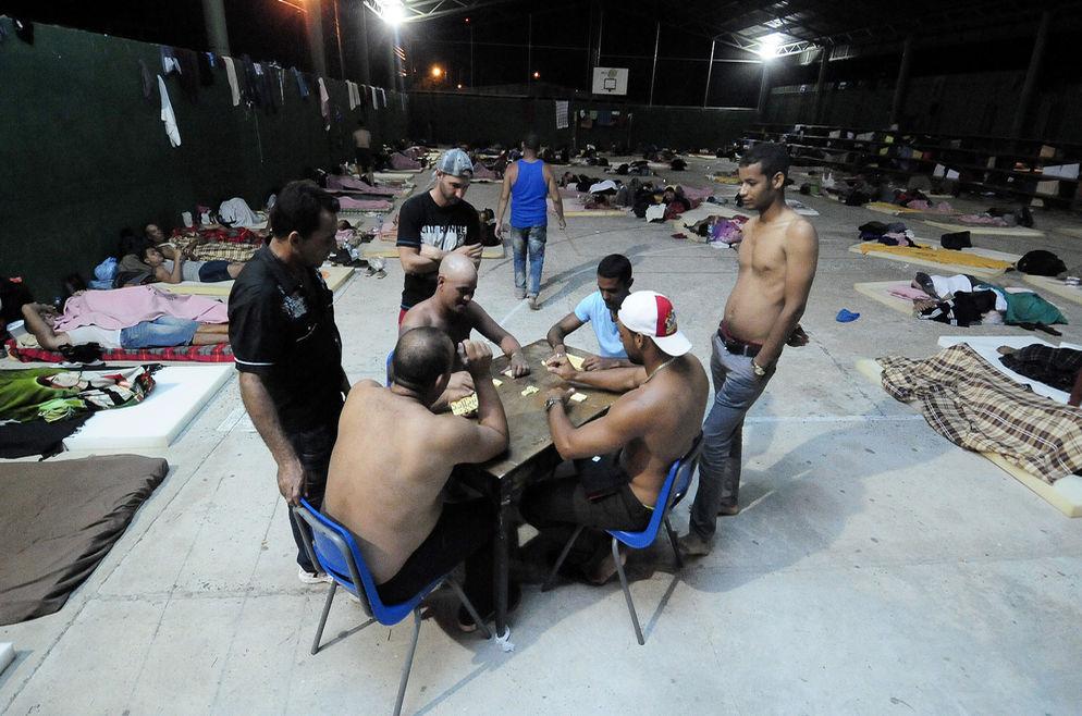 In Costa Rica, Cuban migrants play dominos to pass the time... Photo John Duran, La Nacion