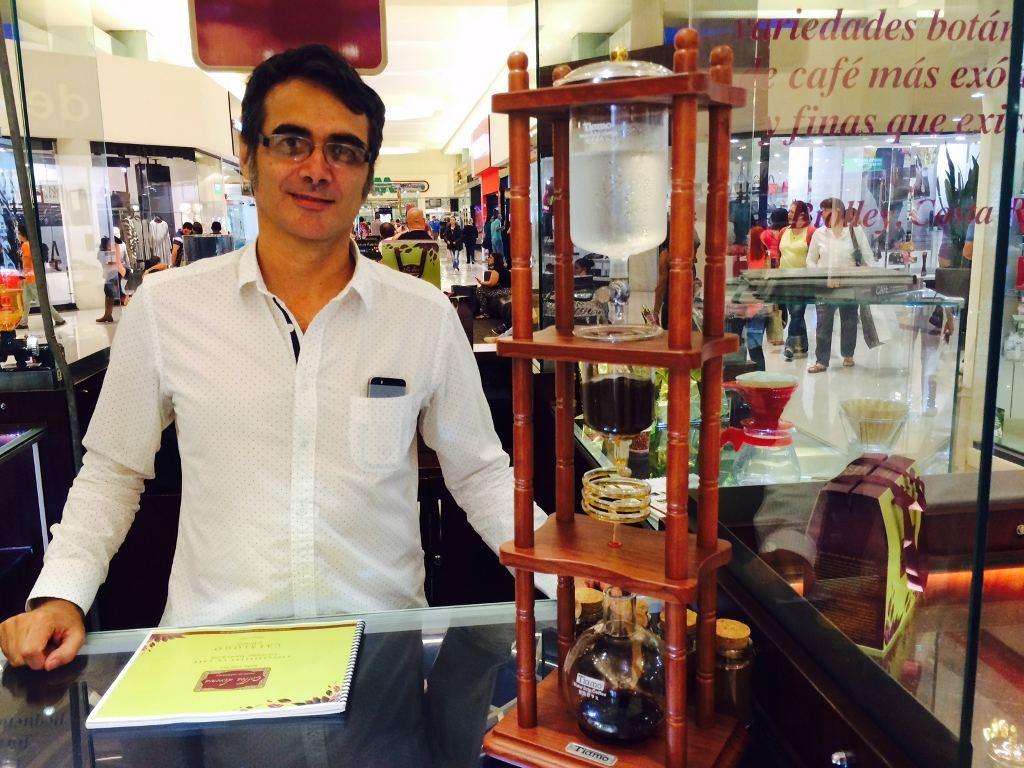 Gonzalo Garcia at his kiosk in Multiplaza Escazu