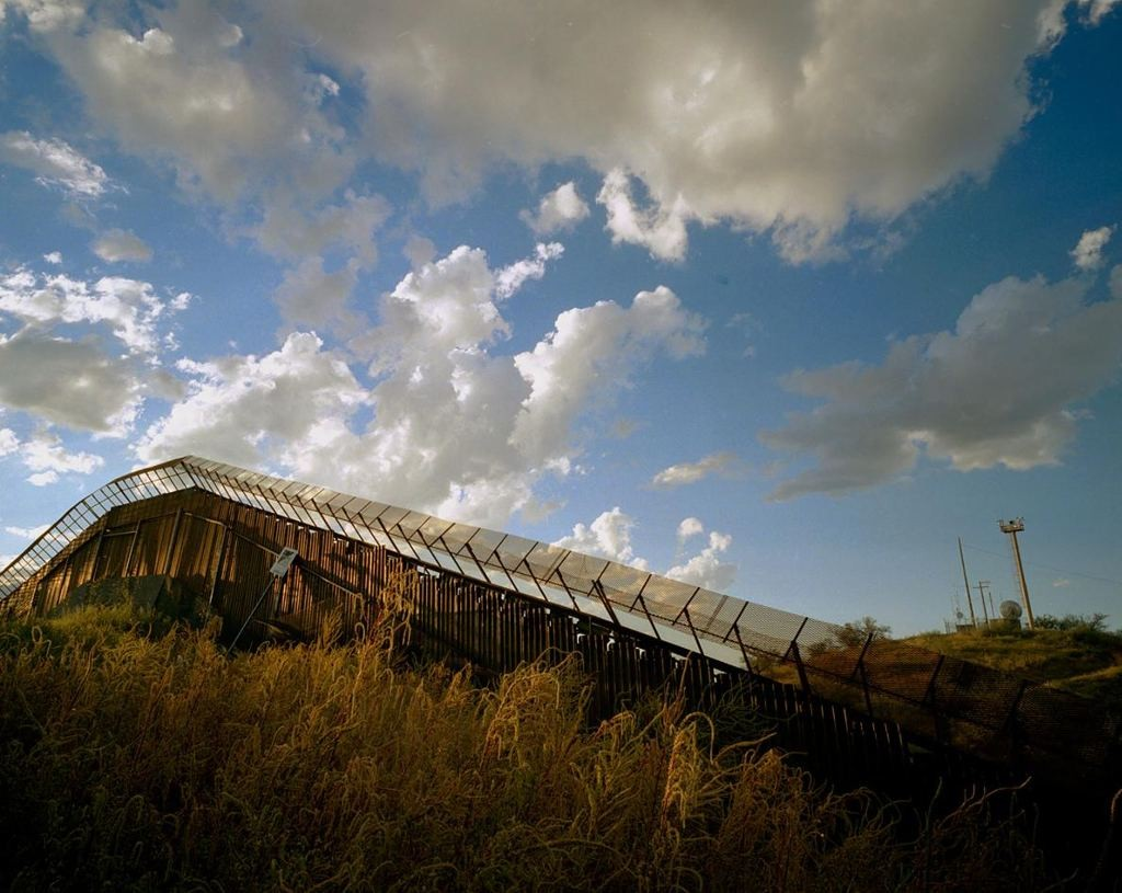 The border town of Nogales is a popular transit point for migrants to cross from Mexico into Arizona, despite fences like this one. photograph by Diane Cook, Jen Jenshel