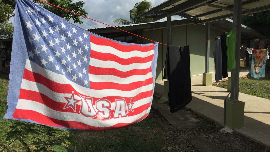 An American flag towel dries at the shelter for Cuban migrants in La Cruz, Costa Rica. U.S. officials say they have no intention of changing laws that generally allow Cubans who reach American soil to stay, but those fleeing the island are doubtful.