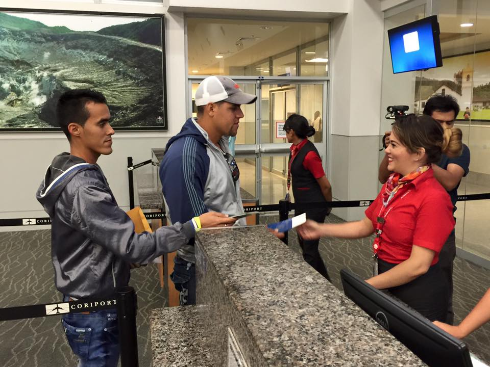 The first group of Cubans stranded in Costa Rica check-in at the Daniel Oduber International airport in Liberia for their flight to El Salvador.