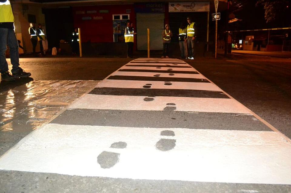 Community organizes to paint cross walk on public street. Photo Facebook