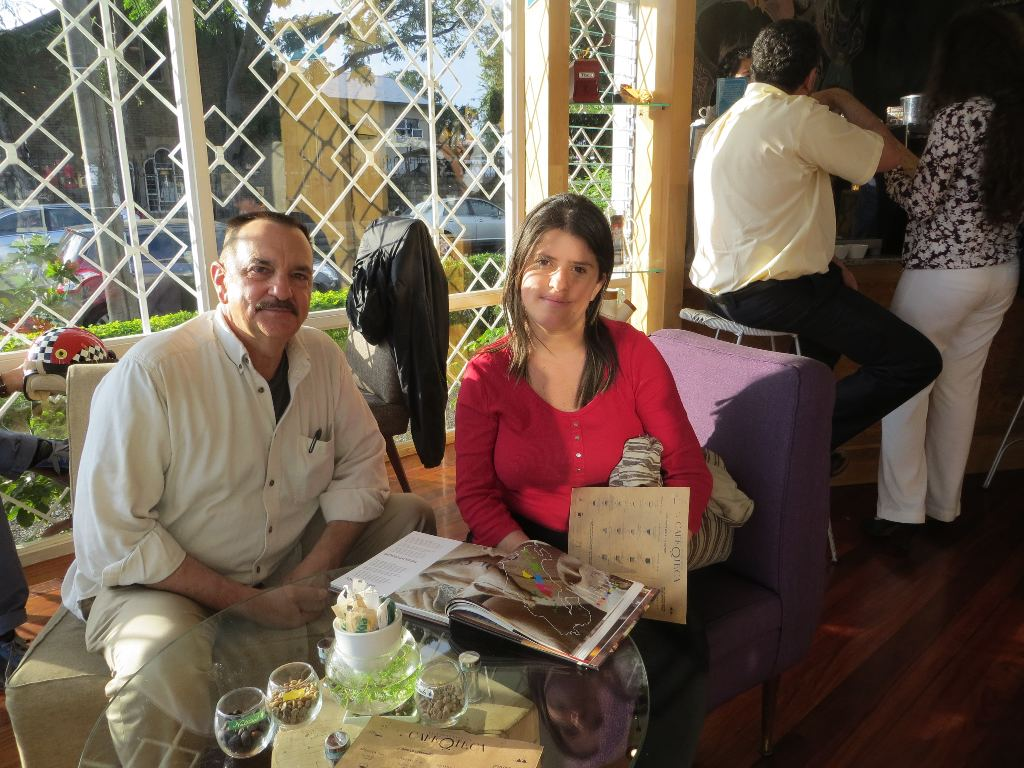 Author Michael Miller with famous San Jose guide, Nury Mora Vargas, study the different coffee growing regions of Costa Rica at Cafe Oteca.