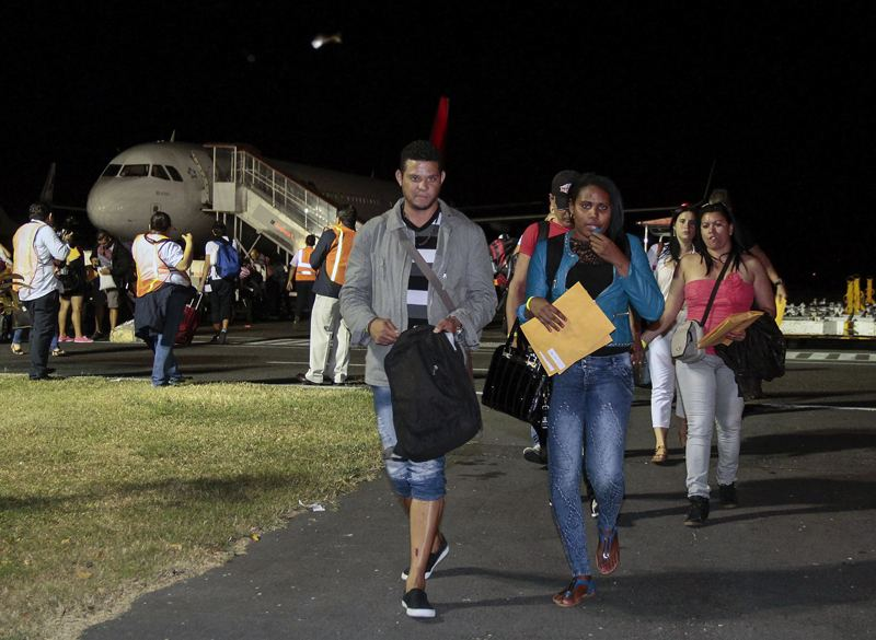 Cuban migrants arriving in EL Salvador after leaving Costa Rica in test run arranged through diplomatic efforts involving several Central American countries
