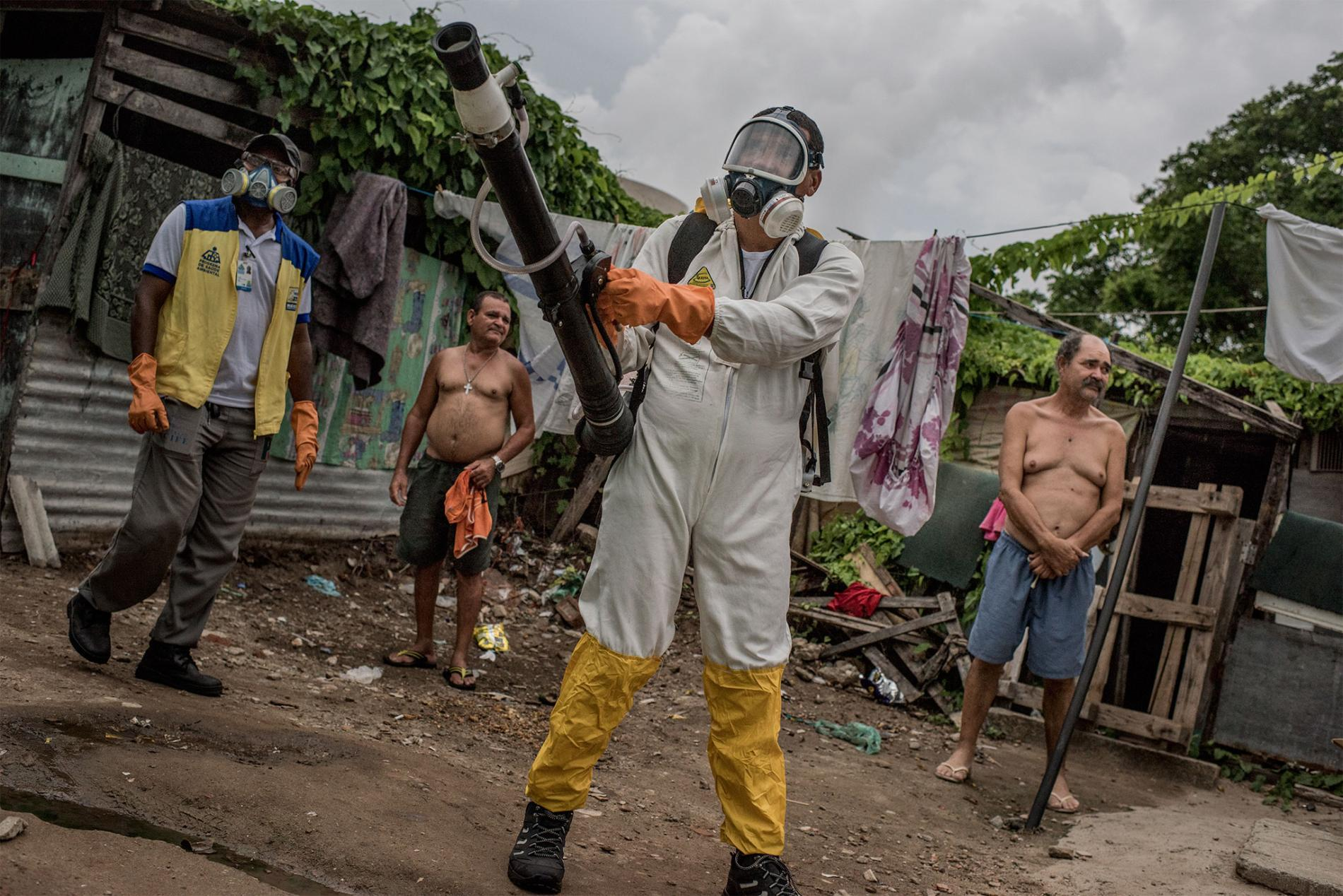 A health worker fumigates a poor favela, or slum, in the city of Recife, Brazil. Fumigating is one of the government's efforts to prevent the spread of Zika.