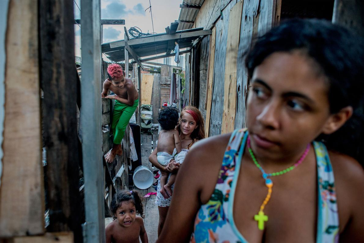 All eight members of Regina Kelli Siqueira's family have had chikungunya and dengue, and may have had Zika as well. She and her six children live in a poor neighborhood called Coelho, in Recife.