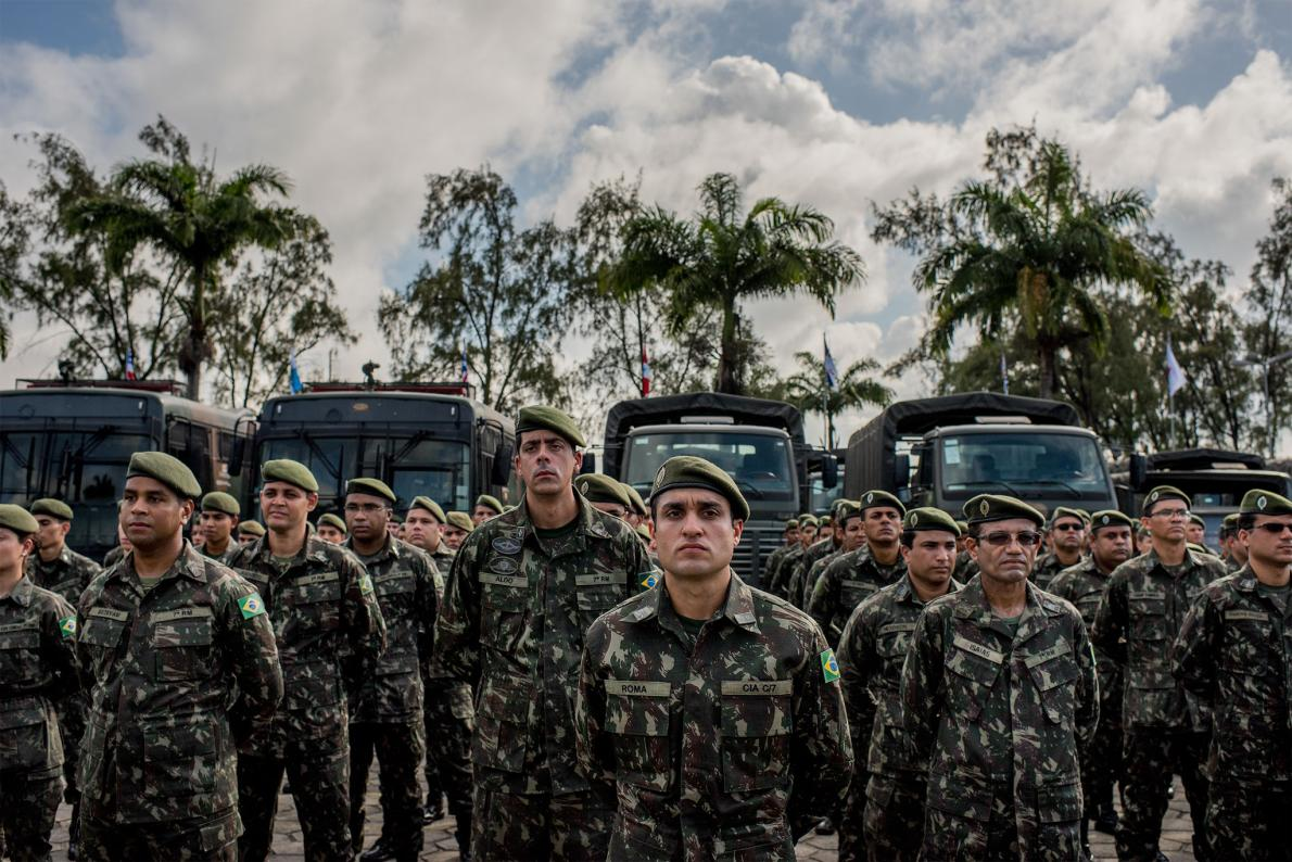 Soldiers in the Brazilian Army line up in the early morning before going door-to-door delivering leaflets with advice for fighting mosquitoes.
