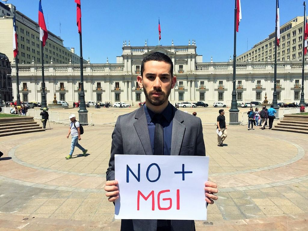 Godoy Peña presents a letter to Chilean president Michelle Bachelet calling for a stop to intersex genital mutilation. Photograph: Camilo Godoy