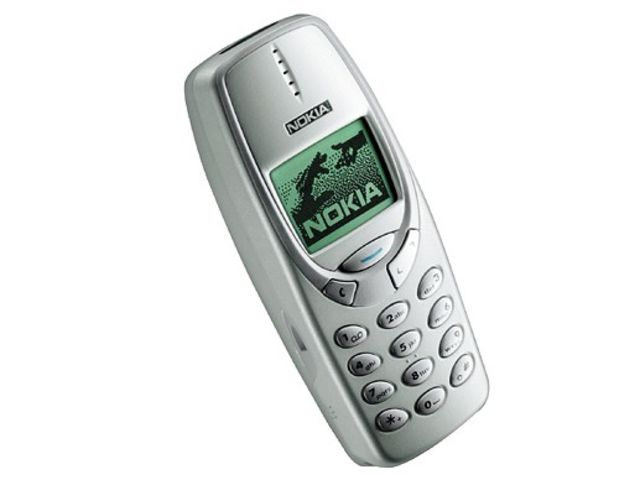 3310. This was many people's first mobile. Virtually indestructable, many a school lunch break was whiled away on Snake II, Space Impact, Bantumi and Pairs II
