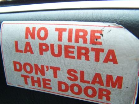 Sign telling people not to slam the door.