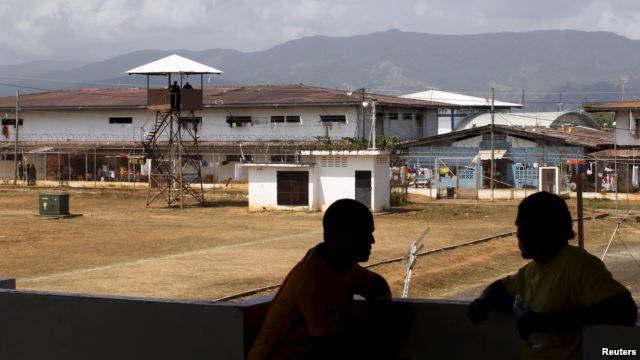Inmates chat at La Joya prison on the outskirts of Panama City, Panama