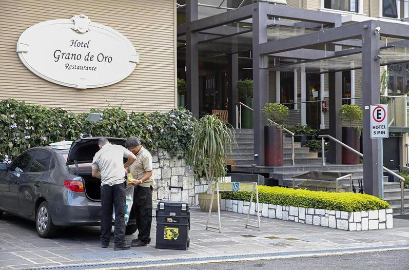 OIJ doing their thing at the Grando de Oro hotel in San Jose, where the body of man to be a Canadian was found in one of the rooms