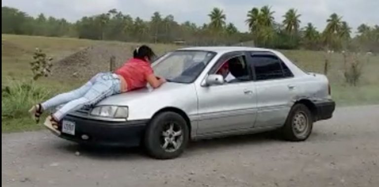 Woman Holds On For Life On Hood Of Car While Jealous 'Husband' Drives Off