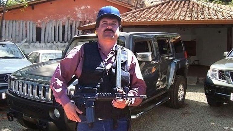 "El Chapo ""Guzman with a rifle in hand. Photo credit: USDOJ - Rolling Stone"