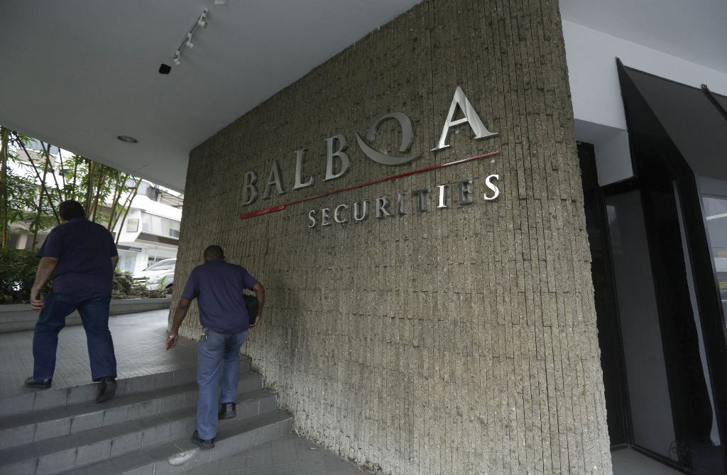 People walk outside the Balboa Bank & Trust Corp. building in Panama City, Thursday, May 5, 2016. Panama authorities took control of the Balboa Bank & Trust Corp. after U.S. officials announced the arrest of a Panama-based businessman who allegedly ran a worldwide money-laundering organization for drug traffickers. (AP Photo/Arnulfo Franco)