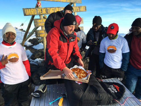 General Manager of Pizza Hut Africa, Randall Blackford, a team of Pizza Hut employees and several professional guides, hiked for six days to the top of Mt. Kilimanjaro to set the Guinness World Records(R) title for the highest altitude pizza delivery on land at a height of 19,341 feet in recognition of Pizza Hut entering its 100th country. (Photo: Business Wire)