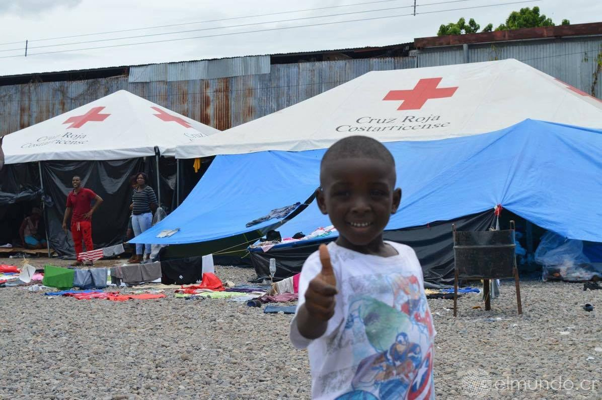 An African child gives Costa Rica the thumbs up. Photo Mauricio Munoz, ElMundo.cr